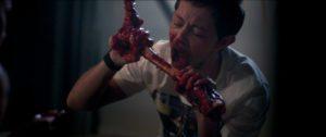 HABIT-Michael-biting-bone-300x126