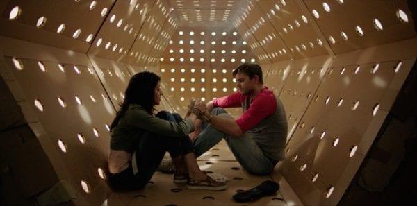 DAVE_MADE_A_MAZE_-_Meera_Rohit_Kumbhani_and_Nick_Thune_in_the_Kubrick_corridor-600x297