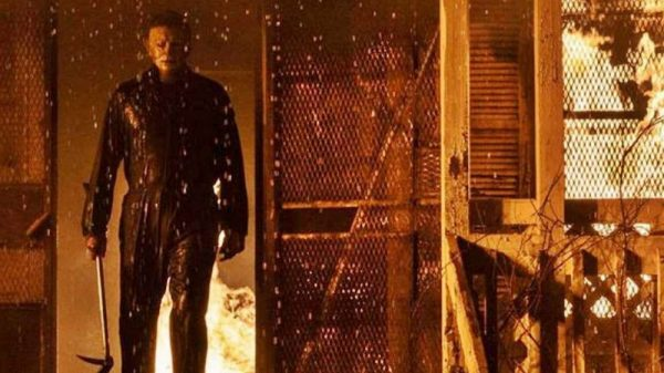 michael-myers-emerges-from-a-burning-house-in-halloween-kills-1611180535-600x337