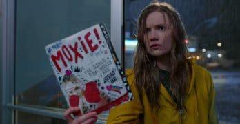 Vivian holding up the Moxie magazine