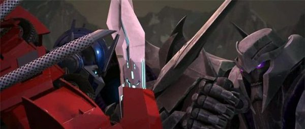 Transformers-Prime-Optimus-vs-Megatron-600x254